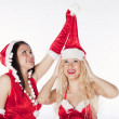 Two sexy Santa girls having fun on a Christmas party — Stock Photo #4500292