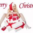 Sexy girl with blonde curly hair dressed as Santa having fun on Christmas — Stockfoto