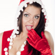 A beautiful brunette girl dressed as Santa's helper having fun — Foto de Stock