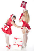 Two sexy Santa girls having fun on a Christmas party — Stock Photo