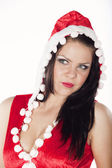 A beautiful brunette girl dressed as Santa's helper having fun on a Ch — Stock Photo