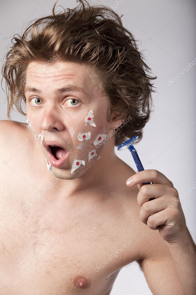 Young topless sexy man had bad luck while he was shaving with a razor. See more in my portfolio. — Stock Photo #4739582