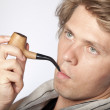 Attractive young man smoking pipe — Stock Photo #4756236