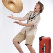Happy young tourist catching a sombrero — Stock Photo #4934816