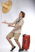 Young tourist catching a sombrero — Stock Photo