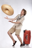 Happy young tourist catching a sombrero — Stock Photo