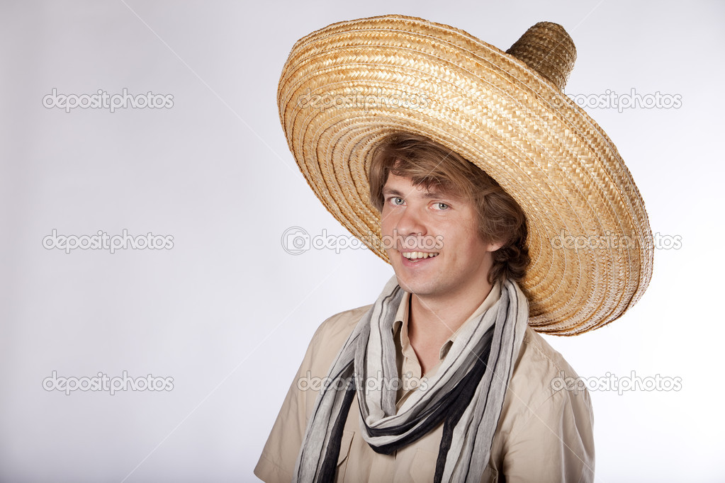 Happy young mexican man with sombrero looking at the camera and smiling — Stock Photo #4934822