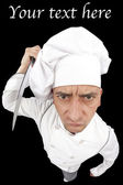 Angry chef holding a kitchen knife — Stock Photo