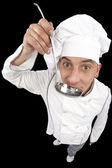 Chef tasting soup from ladle — Stock Photo