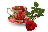Tea in a cup with a rose — Stok fotoğraf