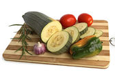 Zucchini with vegetables on the board — Stok fotoğraf