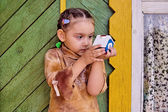 Girl with toy house — Stok fotoğraf