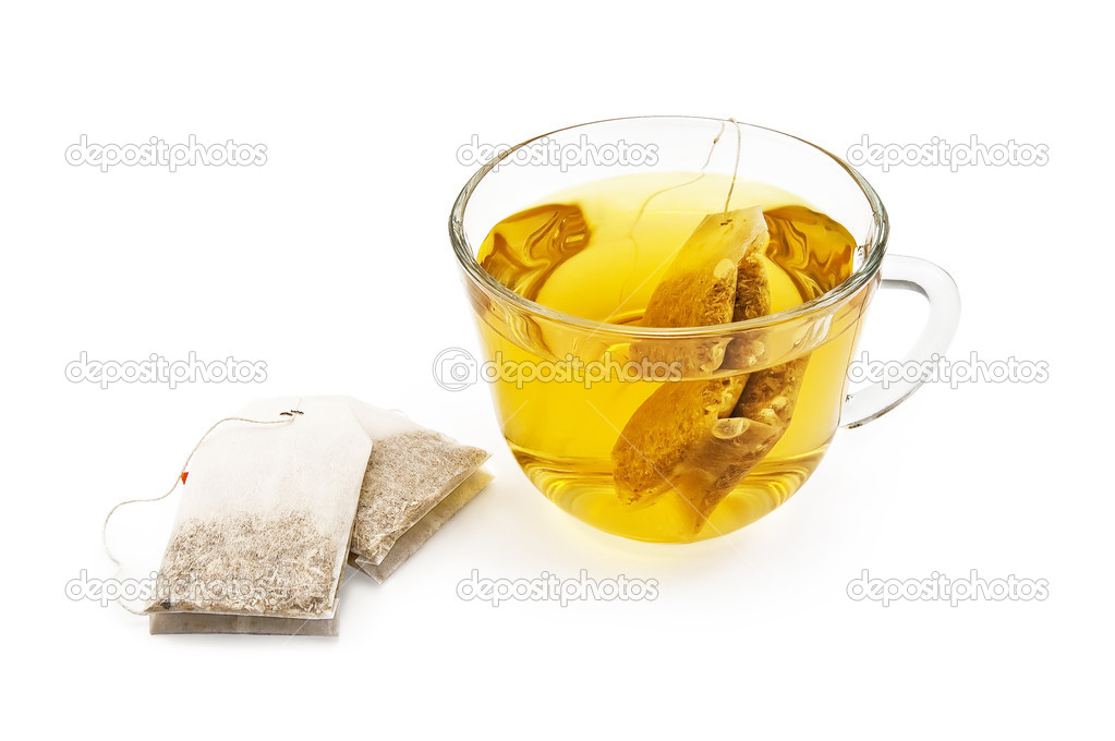 Green herbal tea from a bag in a glass cup, two sachets of herbal tea isolated on a white background — Stock Photo #4749567