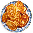 Golden pancakes on a plate — Stock Photo