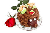Cake in the form of a hedgehog with a rose — Stock Photo