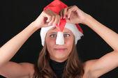 The girl in a red Santa's cap — Stock Photo