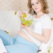Pregnant woman in bed eating — Stock Photo #4891924