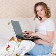 Pregnant young woman using a laptop — Stock Photo