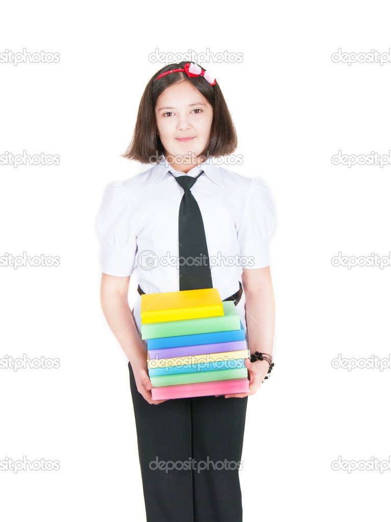 The schoolgirl holds textbooks on a white background  Stock Photo #5290103