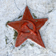 Red soviet star on cracked wall of a monument — Stock Photo