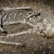Stock Photo: Grave burial skeleton humbones
