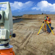 Theodolite survey outdoors - Stock Photo