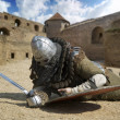 Medieval warrior defeated lying inside the fortress Belgorod Ukrai — Stock Photo