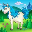 Cute unicorn in forest - Stock Photo