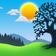Leafy tree silhouette in landscape — Stock Photo