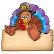 Wooden board with lurking turkey — Stock Photo