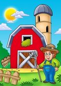 Big red barn with farmer — Stock Photo
