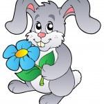 Cute bunny holding flower — Stock Vector