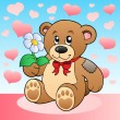Teddy bear with flower and hearts — Stock Vector