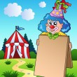 Clown holding board near tent — Stock Vector #5293822