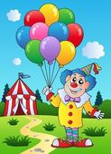 Clown with balloons near tent — Stock Vector