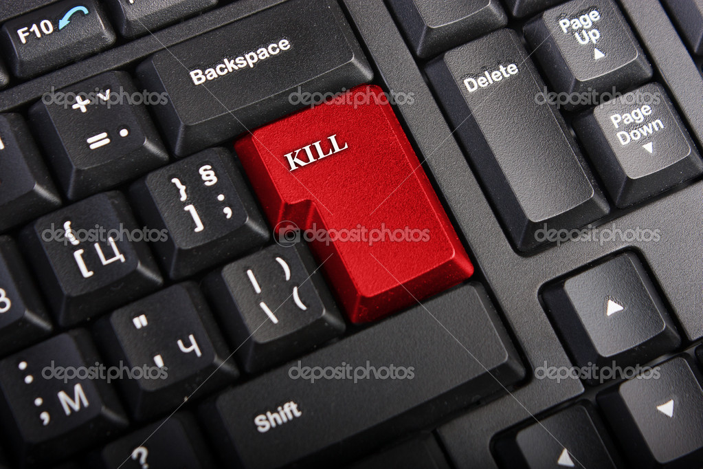 Keyboard with selective focus on the enter button saying KILL  Stock Photo #4505043