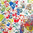 Color handprints wall, hands heap diversity background, finger-print. — Stock Photo #3977477