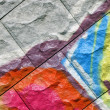 Abstract color graffiti, painted stone background closeup — Stock Photo