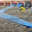 Color cables heap on sand, construction site diversity. — Stock Photo