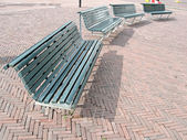 Few street bench on red brick, rest objects — Stock Photo