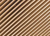 Golden modern metallic grid industrial surface — Stock Photo
