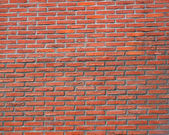 Big red long brick wall, background texture, material — Stock Photo
