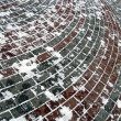 Street red brick under snow, winter weather — ストック写真
