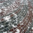 Street red brick under snow, winter weather - Stock Photo