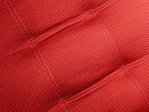 Abstract red textile background closeup, industry details. — Stock Photo