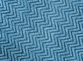 Abstract blue zigzag carpet background texture, wool. — Stockfoto