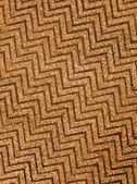 Abstract golden zigzag carpet background texture, wool. — Foto de Stock