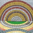 Stock Photo: Colorful round construction brick wall, symmetry details.