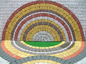 Colorful round construction brick wall, symmetry details. — Stock Photo