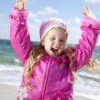 Cute young girl having fun on the beach — Stock Photo